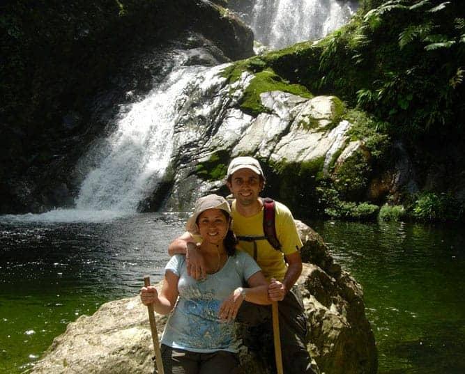 Darius and Shana in front of waterfall in Honduras